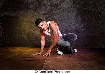Hispanic male hip-hop dancing - A shot of a hispanic male...
