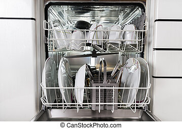 Utensils In Dishwasher - Photo Of Utensils Arranged In...