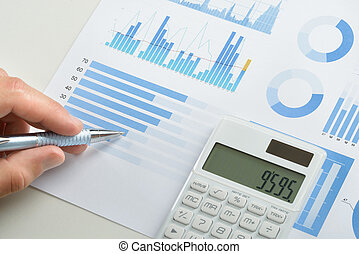 Businessman Doing Calculations - Businessman With Pen Over...