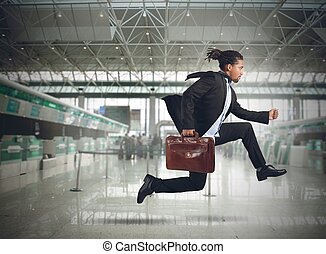 Late businessman - Businessman runs in the airport because...