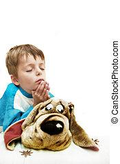 High-key image of little boy praying.