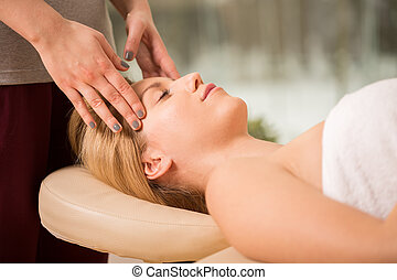 Head massage - Young pretty woman during her head massage