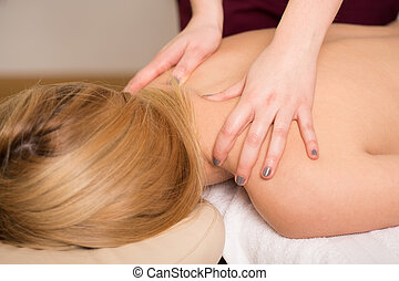 Back massage - Young attractive woman having her back...