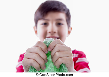 Boy holding bubble wrap. - A young boy can't resist the...