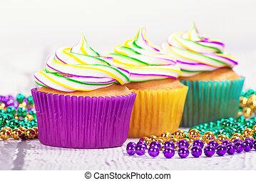 Mardi Gras cupcakes and beads