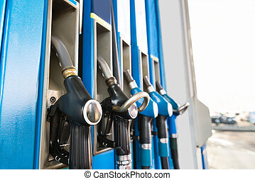Fuel Pumps At A Gas Station - Close-up Of Fuel Pump Nozzles...