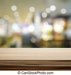 Empty wooden shelf and blurred background for product presentati