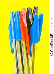 Ball Point Pens - Ball point pens isolated against a yellow...