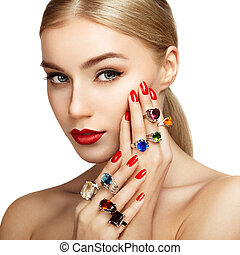 Portrait of beautiful woman with jewelry. Manicure and...