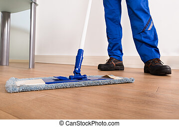 Janitor Mopping - Low Section Of A Janitor Mopping Floor