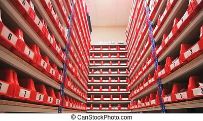 red shelves in stock in car spare parts shop