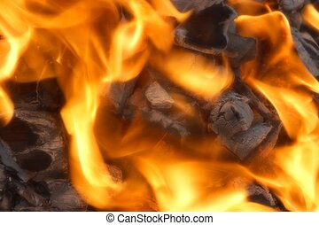 Glowing Coals in BBQ Pit. Background and Texture for text or...