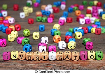Sign INVESTIGATION and many wooden cubes with letters - Sign...