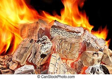 Flaming Coals Close-up - Hot Flaming Coals Close-up on Black...