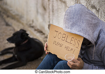 Jobless seek help - Close up of poor young guy with...