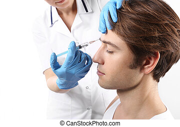 Beauty medicine, reduction of wrink - The young man is a...