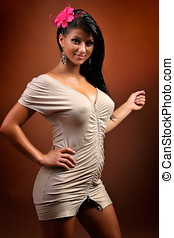 beautiful young sensual woman posing in short dress - studio...