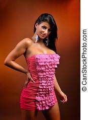 beautiful young sensual woman posing in short dress - studio...