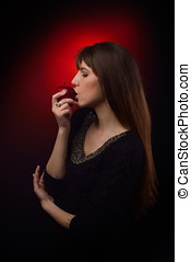 beautiful woman eating red apple