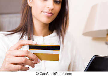 online banking woman - a woman doing online banking with...