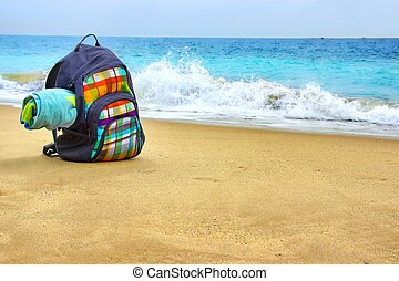 Travel Backpack with Towel on the Sea Beach