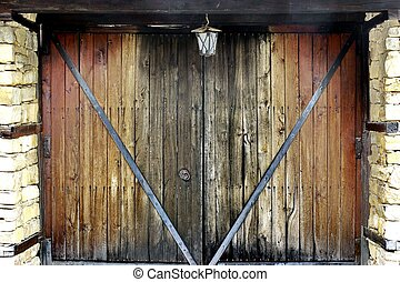 Old Wooden Gate with forging nails and handle Background and...