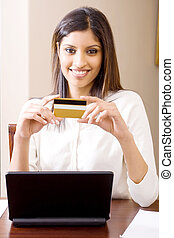 woman doing banking online - a smiling woman with laptop and...