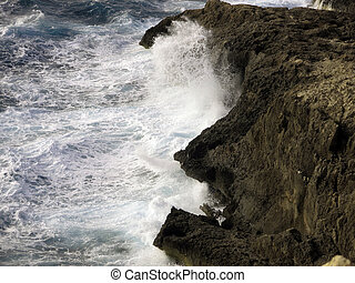high cliff on the sea with big waves