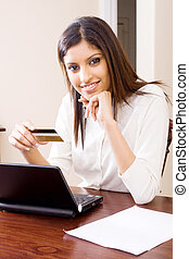 budgeting woman - a woman doing her budget online with...