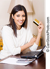 woman doing internet banking - a smiling woman holding a...