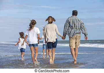 Family Parents Girl Children Walking on Beach - Rear view of...