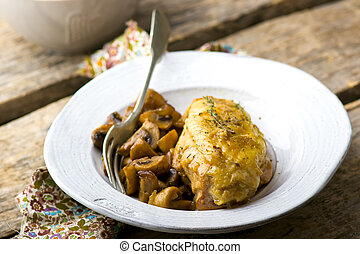 stewed chicken breast with mushrooms in the crock-pot. -...