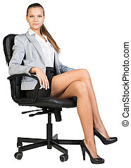 Businesswoman in office chair with straight back and crossed...