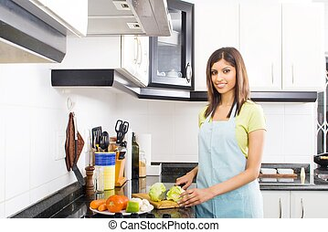 beautiful woman in kitchen - a beautiful asian woman in...