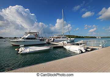 Harbor on the island of Cayo Largo with a sky full of clouds