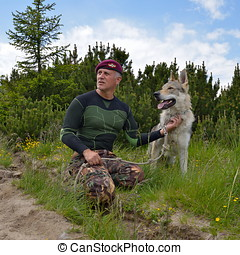 Man and his purebred Czechoslovakian wolf dog