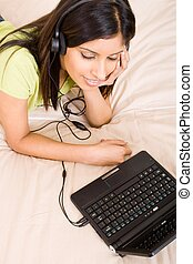 relaxing woman listening music - a woman listening to music...