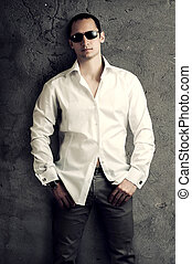 sexy man wearing white luxury shirt - Fashion portrait of...