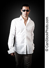 young sexy man wearing white luxury shirt - Fashion portrait...