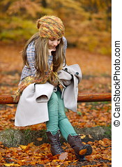 young woman outdoor in autumn - young smiling woman portrait...