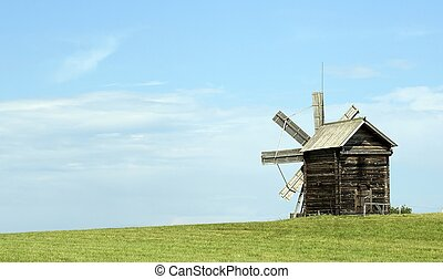 Old Russian windmill in a field, a wonderful rustic look -...