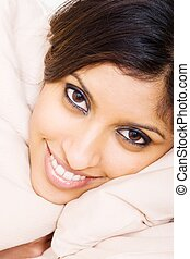 gorgeous indian lady - a gorgeous indian lady lying on a...