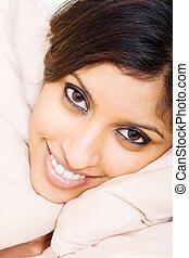 gorgeous indian lady - a gorgeous indian lady lying on a...