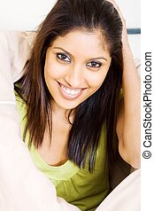 indian young woman - a indian young woman in the bedroom...