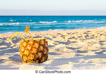 Pina Colada drink in fresh pineapple on the beach