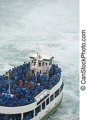 Boat full of men under Niagara waterfall