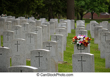 Fallen heroes cemetery with flowers in North America -...