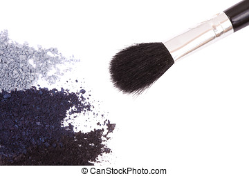Crisp eyeshadow makeup and brush on a white background