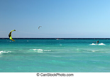 Kite boarding - Mans riding his kiteboard on Varadero beach