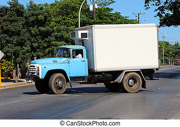 Old Cuban truck driving on a Cuban street